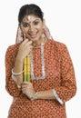 Woman holding a Dandiya at Navratri