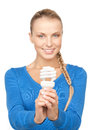 Woman holding energy saving bulb bright picture of Royalty Free Stock Photo