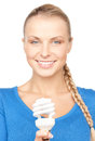 Woman holding energy saving bulb bright picture of Royalty Free Stock Photos