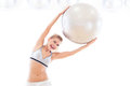 Woman holding exercise ball young Royalty Free Stock Photo