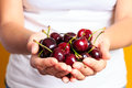 Woman is holding few sweet red cherry in his hand's Royalty Free Stock Photo