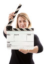 Woman holding film clapperboard an open on a white background selective focus on the board Royalty Free Stock Photos