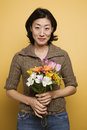 Woman holding flowers. Stock Photos