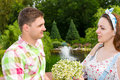 Woman holding flowers while cute man looks at her Royalty Free Stock Photo