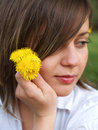 Woman holding flowers on the grass Royalty Free Stock Photography