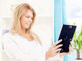 Woman holding frame of photo at home Royalty Free Stock Photos