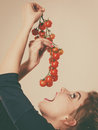 Woman holding fresh cherry tomatoes