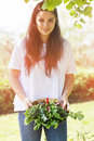 Woman holding freshly harvested vegetables Royalty Free Stock Photo