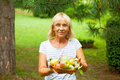 Woman holding fruits happy mature Stock Photos