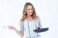 Woman holding frying pan and wooden spoon Royalty Free Stock Photo