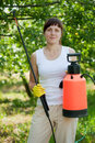 Woman holding garden spray in the yard Stock Image