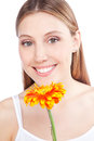 Woman holding gerbera flower young happy isolated on white background Royalty Free Stock Photography