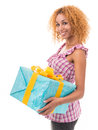 Woman holding a gift Royalty Free Stock Images