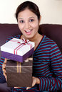 Woman holding a gift box Royalty Free Stock Image