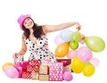 Woman holding gift box at birthday party. Royalty Free Stock Photo