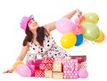 Woman holding gift box at birthday party. Stock Photo