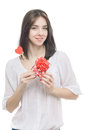 Woman and holding gift box and heart in her hands Stock Photo