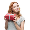 Woman holding gift caucasian happy isolated on white background Stock Photos