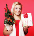 Woman holding gift and the tree happy Royalty Free Stock Photos
