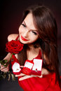 Woman holding gift on Valentine's Day . Stock Images