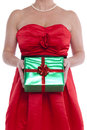 Woman holding gift wrapped present. Royalty Free Stock Photo