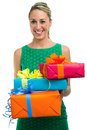 Woman holding gifts girl and offering christmas in white background Royalty Free Stock Images