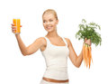 Woman holding glass of juice and carrots Royalty Free Stock Photo