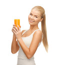 Woman holding glass of orange juice young Stock Photography