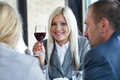Woman holding glass of red wine and toasting Stock Photo