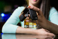 Woman holding a glass of whiskey and car keys Royalty Free Stock Photo
