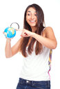Woman holding a globe and using a magnifying glass pretty female while standing against white background Stock Photo