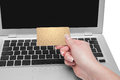 Woman holding gold credit card in hand on line shopping on the internet using a laptop Stock Photography