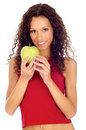 Woman holding greeen apple curl hair brunette isolated Stock Photo