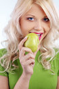 Woman holding green apple Stock Photography