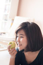 Woman holding green apple with happy smiling.
