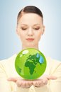 Woman holding green globe in her hands Royalty Free Stock Photo