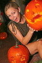 Woman holding halloween lantern portrait of happy young an anthropomorphic vertical shot Royalty Free Stock Images
