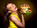 Woman holding hamburger slim Stock Photo