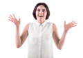 A woman holding hands up in excitement. A happy and crazy young woman isolated on a white background. A funny brunette lady. Royalty Free Stock Photo