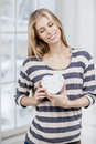 Woman holding heart shaped gift box Royalty Free Stock Photo