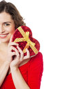 Woman holding heart shaped gift cropped image of a cheerful up Royalty Free Stock Image