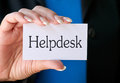 Woman Holding Helpdesk Sign Stock Photos