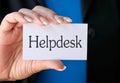 Woman Holding Helpdesk Sign Stock Photos