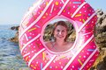 Woman holding inflatable doughnut Royalty Free Stock Photo