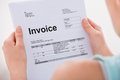 Woman holding invoice Royalty Free Stock Photo