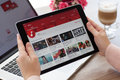 Woman holding iPad Pro Space Gray with YouTube on screen Royalty Free Stock Photo