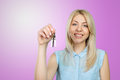 Woman holding keys Royalty Free Stock Photo