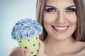 Woman holding little pot with flowers close up of smiling blue flower in Stock Photos