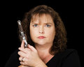 Woman holding loaded gun angry Stock Photography