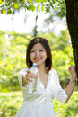 Woman holding mineral water Stock Photography